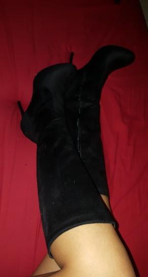 high heeled black knee high mid calf boots